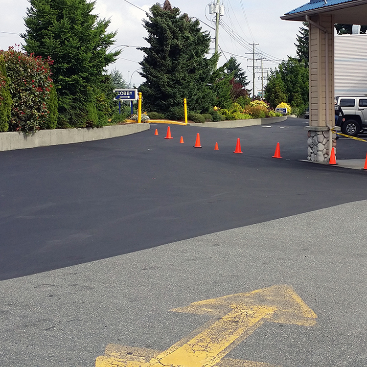 Freshly sealcoated asphalt with pylons set up
